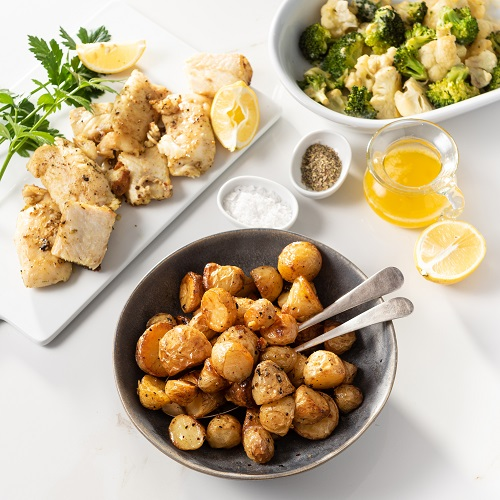 Potatonation Recipe - Oven baked new potato served with grilled fish - featured image