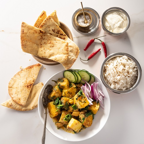 Potatonation - Aloo Palak served with naan bread - featured image