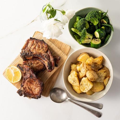 Potatonation - Crispy roast potatoes, oven baked pork chops and greens - featured image