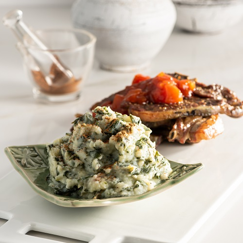Potatonation recipe - Creamy spinach mash served with lamb chops and tomato gravy - featured image