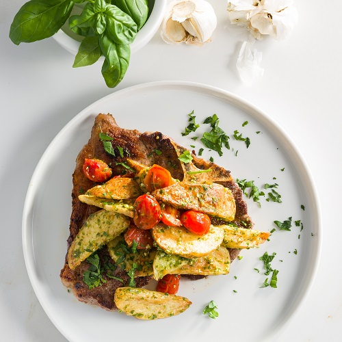 Potatonation recipe - Roasted potato and tomato pesto served with grilled T-bone steak - featured image