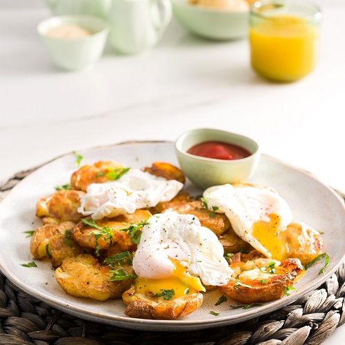 Potatonation recipe - Smashed grilled potatoes topped with poached egg and bacon - featured image