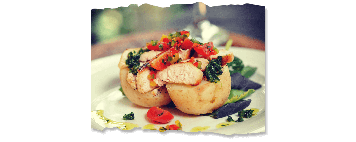 Boiled Potato with Grilled Chicken and rocket Pesto topped with Cocktail Salsa Image