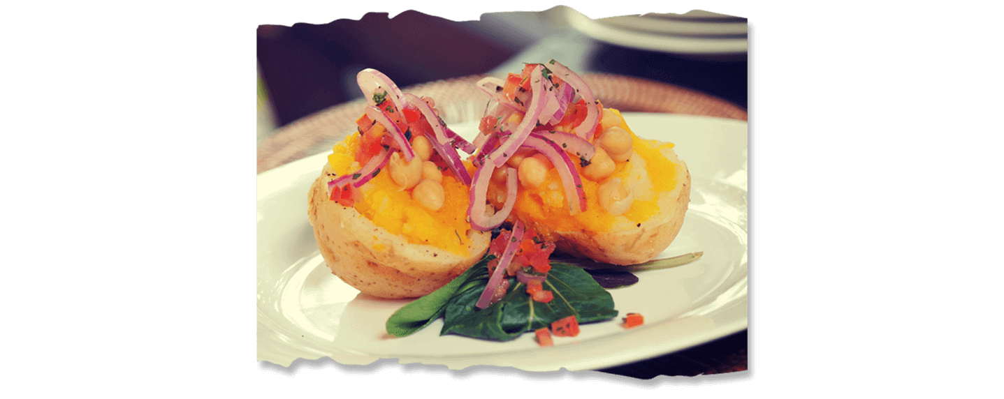 Butternut and chickpea stuffed potato with a tomato herb salsa Image